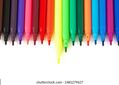 Multicolored felt-tip pens markers highlighters isolated on white background, one is not like all concept, team leader concept