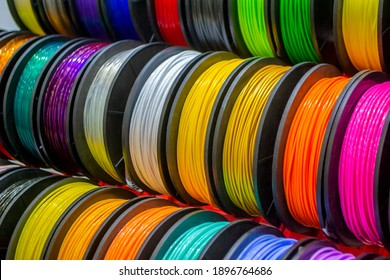 Multicolored filaments of plastic for printing on 3D printer close-up. Spools of 3D printing motley different colors thermoplastic filament. Motley ABS wire plastic for 3d printer. Additive technology