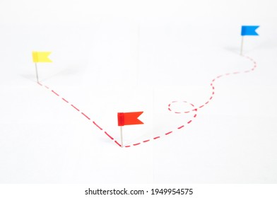 multi-colored flags indicate two routes with a dotted line long and short on a white background, isolated