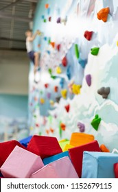 Multicolored foam cubes on the playground in the climbing center. Cliffhanger out of focus
