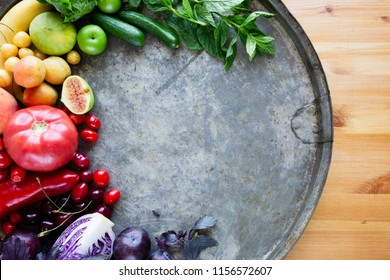 Multicolored fresh fruits and vegetables on a table with copy space