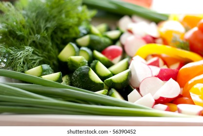 Multi-colored fresh vegetables, cut, on a plate