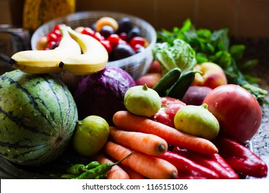 Multicolored fruits and vegetables on a benchtop, selective focus