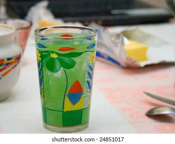 Multi-colored glass on the dinner table (close-up photo)