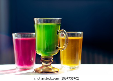 Multicolored glasses of different drinks