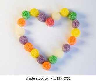 multicolored gumdrop hear made of candy with white background