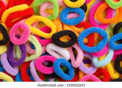 A lot of multi-colored hair ties. Colored hair bands. Scrunchy closeup.