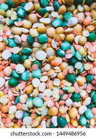 Multicolored halves of peas and grains of lentils