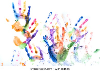 A lot of multicolored hand prints on white background