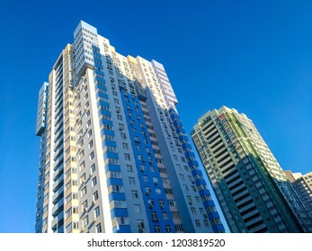 Multi-colored high-rises on the background of blue sky, minimalist modern composition