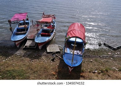 Multi-colored holiday tourist boats on the hore of the lake