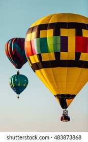 Multicolored hot air balloons isolated against a clear sky