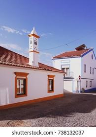 Multi-colored houses on the old streets of the city. Vila Nova de Milfontes. Portugal.