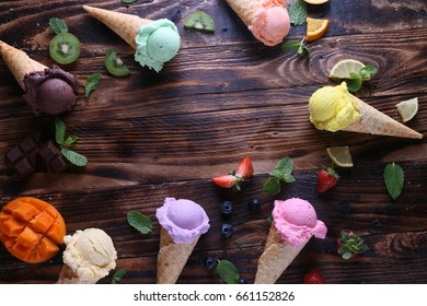 Multicolored Ice cream on wooden table.