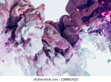 multicolored ink in water, abstract volumetric forms, dissolution in water.