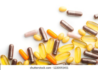 Multicolored Isolated Pills and Capsules on the White Surface