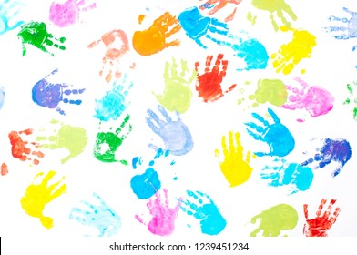 Multicolored kids handprints on white background. Top view, flat lay.