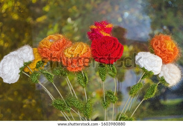 multicolored-knitted-flowers-woolen-thre