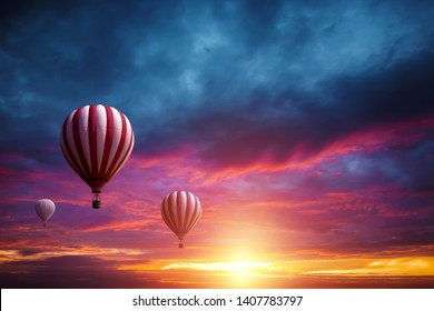 Multicolored, large balloons in the sky against the backdrop of a beautiful sunset. Concept of travel, dream, new emotions.