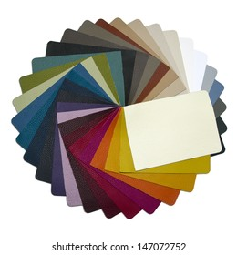 multicolored leather samples arranged in a circle - on a neutral background