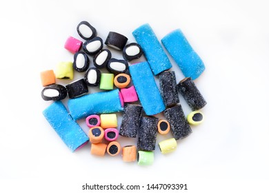 Multicolored licorice candy on a white background.