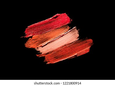 Multicolored lipstic smudge black isolated background