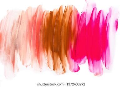 Multicolored lipstic smudge isolated on white background.Red brown orange lipstic smudge.