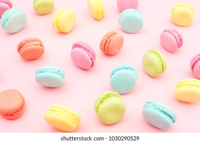 Multicolored macaroons on pink background