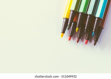 multicolored of magic colors (colours) for paint or draw on paper with copy space and vintage color effect on isolate background.