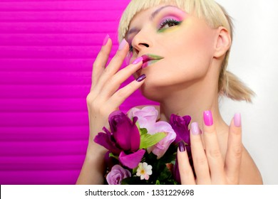 Multi-colored make-up and manicure in pink lilac pastel colors. Saturated make-up. Summer manicure.
