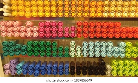 Multi-colored markers on shelves are arranged in rainbows. Stationery and coloring tools. Creativity concept - close-up pens for art, workshop, craft. Ink for artist and designer at art supplies store - Shutterstock ID 1887856849