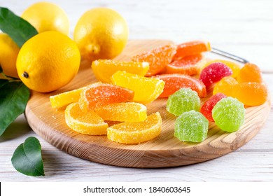 Multi-colored marmalade jelly candy's. Dessert marmalade in the form of lemon and orange slices. The sweetness of jelly candy yellow and orange.