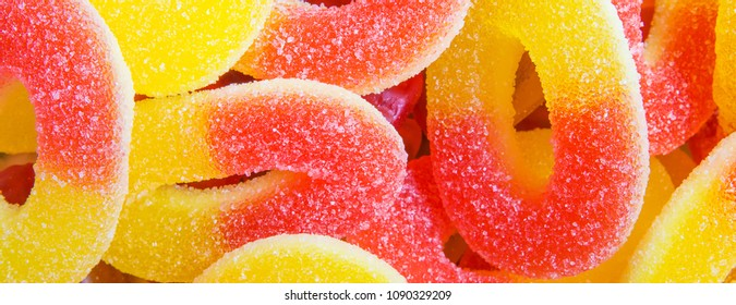 Multicolored marmalade of sweets  Candied fruit jelly on black background,long banner