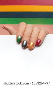 Multi-colored mother of pearl manicure on short nails.Nail design red, green,gray,beige, Golden yellow nail Polish.