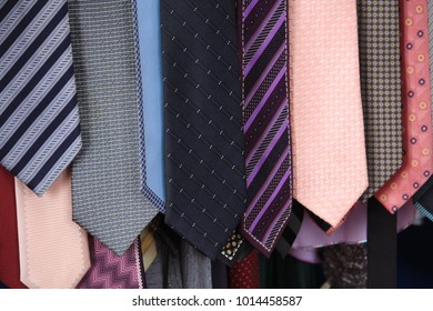 Multi-colored neckties hang together.