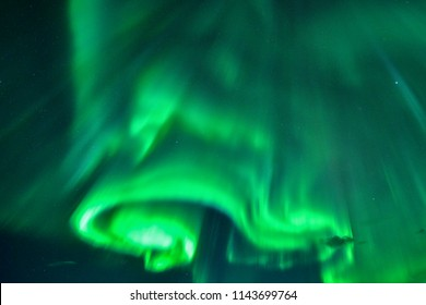 Multicolored northern lights (Aurora borealis) ,A beautiful green aurora dancing with star at night, Iceland