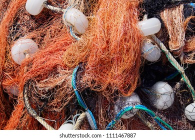 Multi-colored nylon fishing nets and floats in the harbor of Behramkale Assos, Turkey