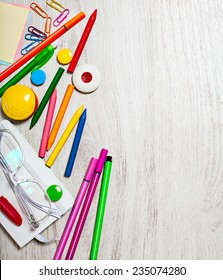 Multicolored office tools assortment on white table