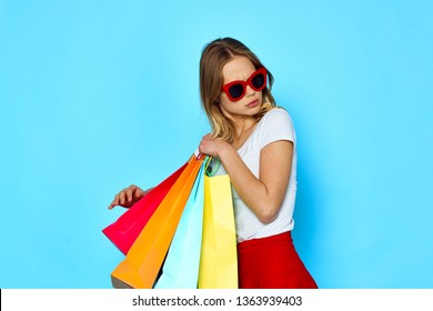Multicolored packages shopping woman glasses skirt shirt
