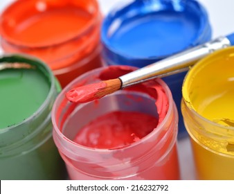 Multicolored paint and brush