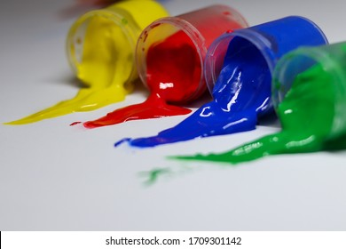 multi-colored paint spilled from jars