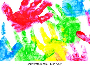 Multicolored painted hand prints on a white background (red, yellow, blue and red colors)