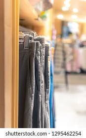Multi-colored pants hung on the rack for sale in department stores.