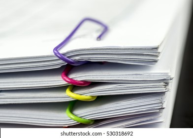 Multicolored paper clips on paperwork