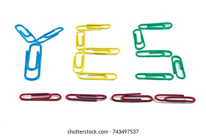 Multi-colored paper clips spelling YES. Red, Yellow, Blue, Green, paper clips. Positive