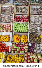 Multicolored particulars vegetables and fruits on the grocery market