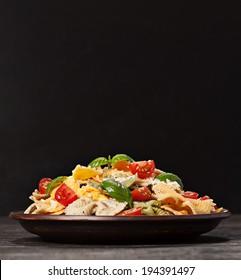 Multicolored pasta on dark background
