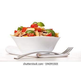 Multicolored pasta on light background