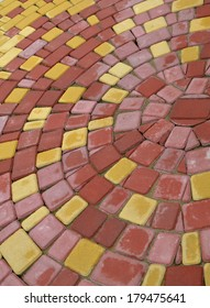 multicolored paving flag round red yellow