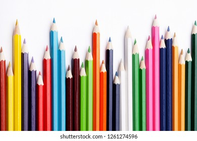 Multicolored pencils on a white background, the concept of business growth, learning. Creative ideas.